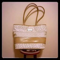 Calvin Klein Almond/Khaki/Camel Tote Like new. Inside/Outside Zipper. Lots of room inside. Calvin Klein Bags Totes