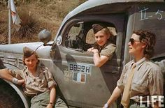 French women drivers posing in front of a Dodge WC-54 Ambulance, 1944. -