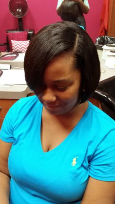 Full sew-in with very little hair left out. Very natural looking. (www.latoyajonesblog.com)