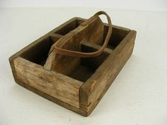 "This vintage primitive pine wood tote measures 12"" x 9""."