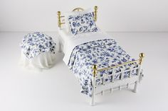 This sweet and bright brass bed with flowery blue bedding and lace-draped nightstand embodies the traditional floral styles of the past. It even coordinates with a matching Bedroom Vanity! 1:12 Scale