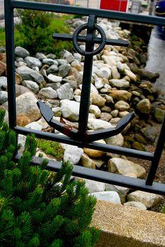 Anchor detail on iron railing.