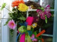 A Bright a cheerful wreath to brighten your day...Easily made starting with a grapevine wreath adding flowers,bow,small bucket and dragonfly which are all available at your local discount store.....