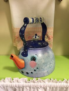 This hand painted snowman tea kettle is for decoration only. It has a navy blue lid with snowflakes adoring it. The body of the kettle has snowflakes painted on the sides with a little glitter sparkles. The spout is the snowman nose. Christmas Snowman, Winter Christmas, Christmas Ornaments, Christmas Projects, Holiday Crafts, Diy And Crafts, Arts And Crafts, Snowman Faces, Snowmen