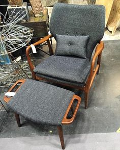 A comfy lounge chair and ottoman with a mid-century vibe. I like the masculine grey fabric. Experienced at #nynow. #pjbjrinteriordesign #chair #ottoman #furniture