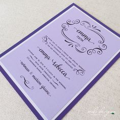 fun purple bat mitzvah invitation with cute curlicues framing the bat mitzvah girl's name