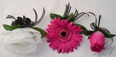 Model: FUBK05  This wedding flower package is made with fuchsia/pink open Roses, white open Roses, fuchsia Daisies accented with black Azaleas.