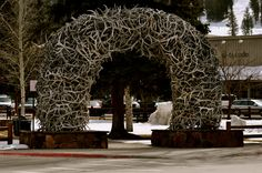 Jackson Hole, WY.  Arch made from shed deer antlers. maybe at the end of the driveway....hmmm.