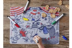 Fantastic color your own placemats that wipe clean like dry erase (without the smudging).  Plus other ideas to keep kids entertained in restaurants without screens
