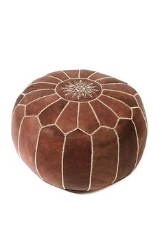 Handmade in Morocco by skilled artisans, this 'parachute' style ottoman features a decorative central panel that is hand-embroidered with silk thread. Leather Pouf Ottoman, Moroccan Leather Pouf, Ottoman Footstool, Moroccan Pouf, Ottomans, Scratched Wood Floors, Floor Pouf, Leather Pieces, Natural Leather