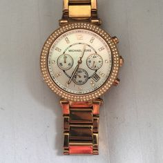 Michael Kors watch rose gold Rose gold, works perfectly. Signs of wear but I'm sure you can get new links for the band to  replace the worn band currently. Needs polishing can be done at any jewelry store. I have too many watches just selling this for extra $$. MK box included Michael Kors Accessories Watches