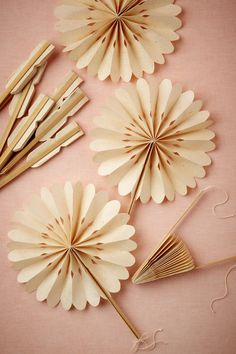 Tuck these hand-crinkled and clipped fans into centerpieces and tablescapes, or use 'em the old fashioned way for a cool breeze. Set of 10. Lokta paper, wood, cotton string. Handma