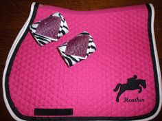 "Custom Saddle Pad set hot pink with black and white trim and black appliqued jumping horse.  Matching zebra polo wraps with bling. $65 available at Etsy and Ebay under ""thebarncloset""."