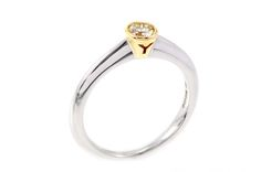 Why Jewellers engagement ring in white and yellow Fairtrade gold.