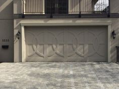 Want a garage door that makes a statement? Custom wood is the way to go.