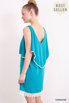 www.freebirdcanada.com International shipping!  This loose fit dress is perfect for summer! the dress features a scoop neck and V back, an overlay for added style. It is simple yet has a crochet trim for a touch of  femininity! 55% Algadon 45% PolyBrand Umgee