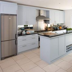 With duck-egg blue cabinetry and sleek stainless-steel appliances, this chic kitchen has an airy and spacious feel. Beautiful Kitchens shows you around some of the most stunning real kitchens in the UK Duck Egg Blue Kitchen Cabinets, Duck Egg Kitchen, Real Kitchen, Blue Kitchen Accessories, Kitchen Island Makeover, Kitchen Colors, Kitchen Ideas, Beautiful Kitchens, Interior Design Kitchen
