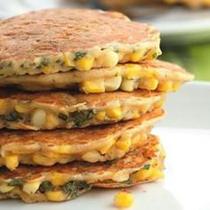 """Corn & Basil Cakes Recipe - Someone who made this recipe said, """"I made these with roasted corn (just grilled on the George Foreman and cut off the cob) and purple basil, with a little sour cream on the side. So good, and super easy. """""""