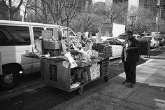 New York Street Photography. A sidewalk vendor.