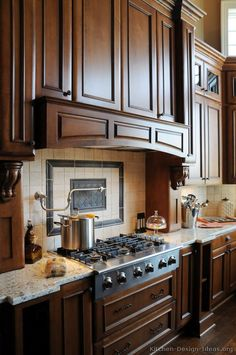 #Kitchen of the Day: A great design for gourmet cooking with a professional range top, a large wood hood, and a pot filler faucet.... Photo # 12 in Traditional Dark Golden-Brown Kitchens (Kitchen-Design-Ideas.org)