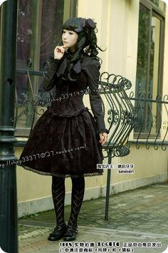 Black bell-shaped skirt, tights, sensible but cute shoes.