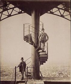 Alexandre Gustave Eiffel poses high on top of the completed Eiffel Tower in 1889