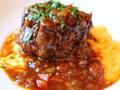"""Kip cooks Osso Bucco & it's wonderful. Risotto Milanese with Osso Bucco. Osso Bucco in Italian means """"Bone with a Hole"""". Veal shanks, or Oxtail is seared and then braised in a sauce with red wine, herbs and beef stock. Oxtail Recipes, Veal Recipes, Dinner Recipes, Recipies, Risotto Recipes, Beef Dishes, Tasty Dishes, Slow Cooking, Gastronomia"""