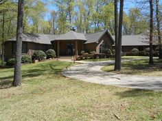 All brick 3 BR 2½ BA, 3 car garage, wooded lot w/additional lot in rear, circular driveway, 2 decks separated by large patio, screened porch, marble entry, 4 sided F.P., breakfast area, formal dining w/vaulted ceiling. Walk-in crawl space in Mountain Home AR