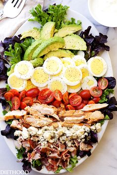 Cobb Salad Recipe - This classic American main-dish salad is packed with chicken, avocado, sweet tomatoes, crunchy bacon, blue cheese, and eggs, all topped with a lightened-up blue cheese dressing. @diethood