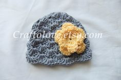 A super cute, soft hand crocheted hat for baby girls in Grey and sunshine yellow. The unique Rose adds unique touch for a beautiful photography prop. Perfect for baby shower gift. Color: Grey and sunshine yellow  Hand wash and lay flat to dry    CHOOSE YOUR SIZE Newborn: 12 to 13  1-3 months: 13- 14  3 to 6 months - 14 to 16 6 to 12 months - 17 to 19    *** This beanie is made to order. Please allow 1-1.5 weeks to complete ***    PHOTOGRAPHERS: if you would like to shoot on my items, please…