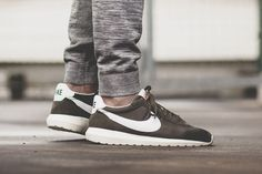 0c8920892cb8 Nike Roshe Cargo Khaki comes built with a mesh base and suede detailing  that also includes leather on the Nike Swoosh logo and heel tab.