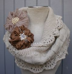This pic goes no where sadly but it gave me the idea of taking an old sweater, cutting a wide band out of it and sewing some kind of lace on both ends and making giant flowers like pictured, looks like yo yos with stuffing in them but with the fabric bunched up. So cute!
