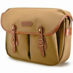 £116.62 Billingham Hadley Large Shoulder Bag - Khaki & Tan. The Hadley Large is an immensely popular bag. The one piece main flap extends from the back of the bag, reducing the number of seams and enhancing the bag's weather resistance. Bellowed front pockets, with press studded expansion, are covered by individual flaps with press stud closure. The Quick Release System allows rapid access, while buckles provide precise adjustment.