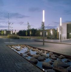 Exterior square, concrete pavement. Pole light. Landscape. Hillerød Library and Information Park: