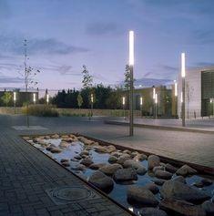 Exterior square, concrete pavement. Pole light. Landscape.  Hillerød Library and Information Park: