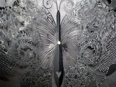 Hina Aoyama has a passion : to create super fine lacy-paper-cuttings with a simple pair of scissors. She uses a mixture of the traditional and modern styles to produce her own world through her own special paper-cuttings technique.