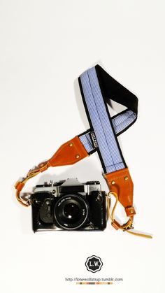 Loving this camera strap by lone wolf...must have when I get my camera
