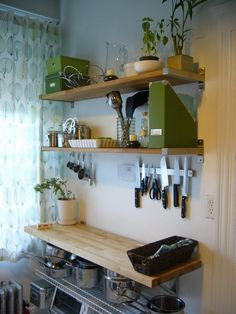 Roomark: Jeremy's Lovely Vertical Kitchen Storage  smart for knife and measuring cup storage above a butcher block cart.