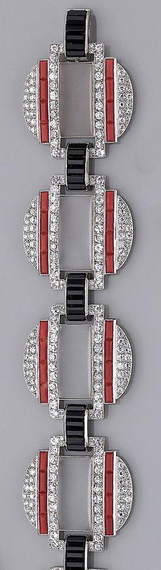 A diamond, coral, onyx, and rock crystal bracelet designed as five circular links, each centering a rectangular panel of frosted rock crystal bordered by round brilliant-cut diamonds and calibré-cut coral, each separated by an arch link of calibré-cut onyx; with fitted box; estimated total diamond weight: 14.75 carats; mounted in platinum; length: 7½in. Art Deco or Art Deco style