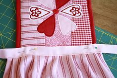 kids apron made from a pot holder and dish towel how cute
