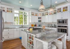 Another view of piracema granite kitchen - blue ceiling