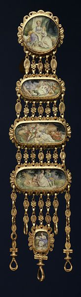 The watch is enameled with a scene of a young couple interrupted by a farmer and is signed by the enamelist Dailly. Since the 19th century, the watch has been suspended from a chatelaine decorated with country scenes in the manner of the noted rococo artist François Boucher. 1830