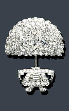 AN ART DECO DIAMOND AND BLACK ENAMEL JABOT PIN, CARTIER  circa 1925