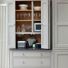 Pale grey kitchen with fitted storage