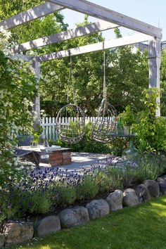 Garden Landscaping Backyard patio pergola with swings.Garden Landscaping Backyard patio pergola with swings