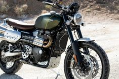 Triumph Scrambler 1200 XC stationary on salt flats with sunlight highlighting the front forks and sculpted exhaust Triumph Scrambler, Triumph 1200, Scrambler Motorcycle, Triumph Bonneville, Triumph Motorcycles, Custom Motorcycles, Custom Bikes, Indian Motorcycles, Girl Motorcycle
