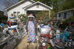 Local folk artist, L. V. Hull, shows off her delightful ethnic yard art in Kosciusko, Mississippi.