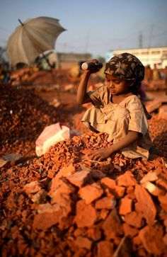 A young girl working in a brick crushing factory in Dhaka :(