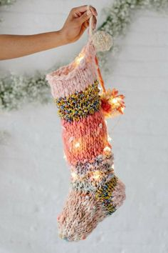 Looking for the perfect Christmas stocking pattern? The Knit Collage Holiday Stocking pattern has you covered! This knit stocking (made here with just 1 of our mini skein sampler kits in Rose) is a quick knit, and the perfect gift this holiday season! Bohemian Christmas, Classy Christmas, Noel Christmas, Christmas Crafts, Christmas Ornaments, Christmas Collage, Pink Christmas, Homemade Christmas, Knit Stockings