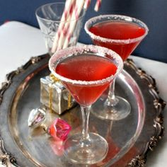 Candy Cane cocktail made with homemade/DIY Candy Cane infused vodka!  Ho, ho, ho.
